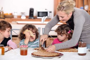 nutella - mother preparing breakfast for kids