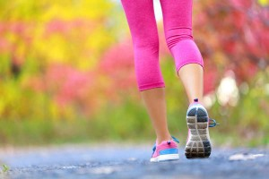 Jogging woman with athletic legs