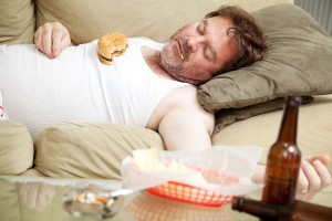 Man lying down after a meal - natural remedies for acid reflux disease
